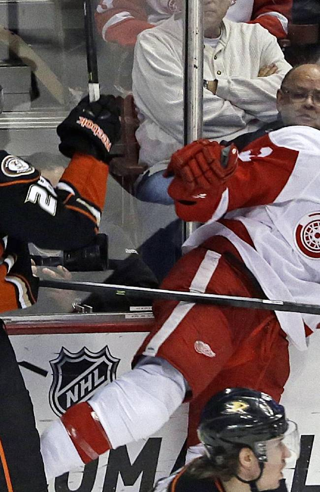 Anaheim Ducks defenseman Mark Fistric (28) and Detroit Red Wings center Darren Helm (43) get tangled up in the third period of an NHL hockey game in Anaheim, Calif., Sunday, Jan. 12, 2014.  The Ducks won 1-0