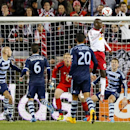 New York Red Bulls forward Bradley Wright-Phillips (99) heads a cornerkick in for a goal for the winning score against Sporting Kansas City in an MLS playoff soccer match at Red Bull Arena in Harrison, N.J., Thursday, Oct. 30, 2014. The Red Bulls defeated