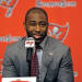 NFL football cornerback Darrelle Revis addresses the media while announcing that the Tampa Bay Buccaneers have acquired him from the New York Jets during an NFL press conference Monday, April, 22, 2013, in Tampa, Fla. The Buccaneers and Revis have agreed on a six-year contract. (AP Photo/Brian Blanco)