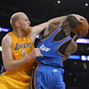 Los Angeles Lakers center Chris Kaman, left, fouls Oklahoma City Thunder power forward Serge Ibaka, of Congo, during the second half of an NBA basketball game, Thursday, Feb. 13, 2014, in Los Angeles The Associated Press