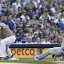 Los Angeles Dodgers' A.J. Ellis is frced oput at third as San Diego Padres third baseman Chase Headley takes in the throw on a failed sacrifice bunt attempt in the fifth inning of the opening game of Major League baseball in the United States Sunday, Marc