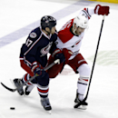 Carolina Hurricanes' Patrick Dwyer, right, works for the puck against Columbus Blue Jackets' Dalton Prout in the third period of an NHL hockey game in Columbus, Ohio, Tuesday, March 18, 2014. Carolina won 3-1 The Associated Press