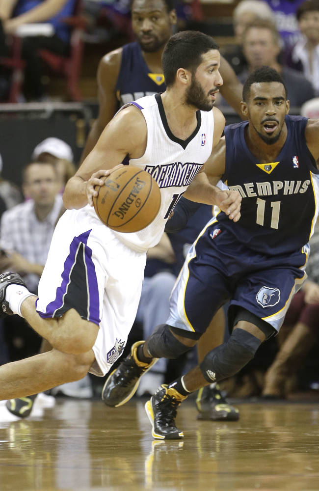 Sacramento Kings guard Greivis Vasquez, of Venezuela, left, drives against Memphis Grizzlies guard Mike Conley, during the first quarter of an NBA basketball game in Sacramento, Calif., Sunday, Nov. 17, 2013