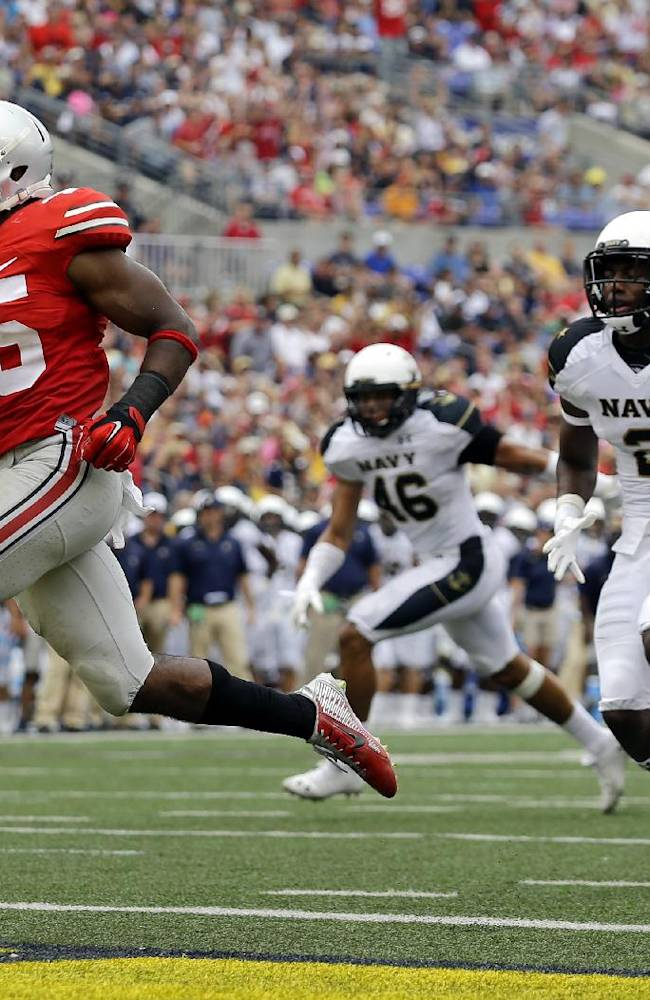 In this Aug. 30, 2014, file photo, Ohio State running back Ezekiel Elliott, left, runs past Navy safety Parrish Gaines (2) and linebacker Chris Johnson (46) for a touchdown in the second half of an NCAA college football game in Baltimore. After a 34-17 victory over Navy in the opener, coach Urban Meyer is pleased with the job done by Elliott, who gained 44 yards on 12 carries including this 10-yard touchdown run