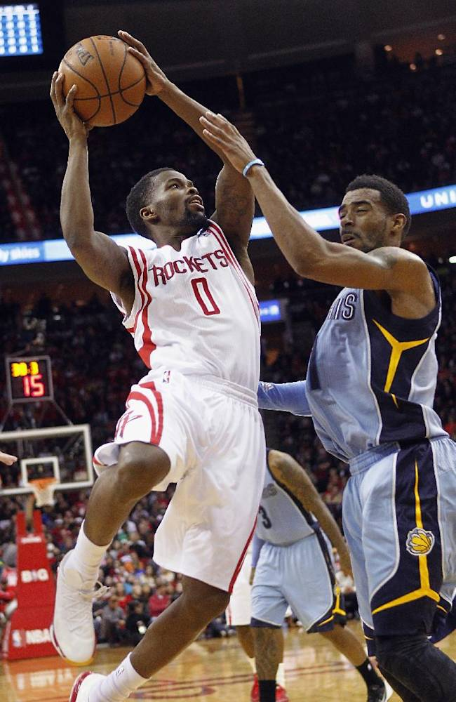 Houston Rockets guard Aaron Brooks (0) makes contact with Memphis Grizzlies Tony Allen on a drive to the basket during the second half of an NBA basketball game Thursday, Dec. 26, 2013, in Houston. The Rockets won 100-92