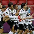 German team mates stretch during a training session ahead of Thursday's Euro 2012 soccer semifinal match between Germany and Italy in Warsaw, Poland, Wednesday, June 27, 2012. (AP Photo/Frank Augstein)