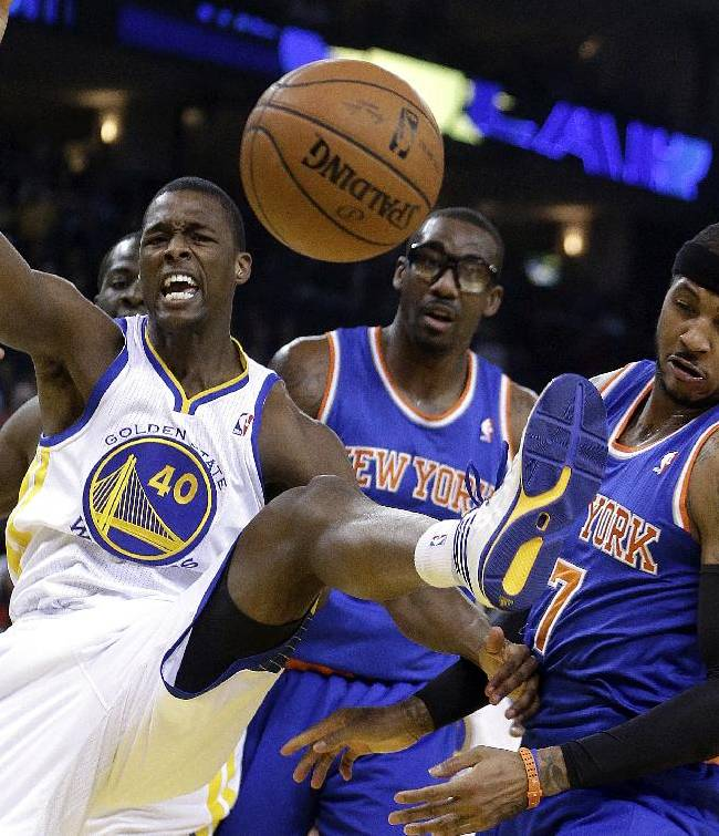 From left, Golden State Warriors' Harrison Barnes (40) New York Knicks' Amar'e Stoudemire, and Knicks Carmelo Anthony (7) eye a rebound during the first half of an NBA basketball game. Sunday, March 30, 2014, in Oakland, Calif