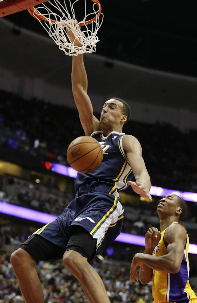 Utah Jazz center Rudy Gobert, left, dunks the ball as Los Angeles Lakers guard Wesley Johnson looks on during the second half of a preseason NBA basketball game in Anaheim, Calif., Friday, Oct. 25, 2013. The Lakers won 111-106