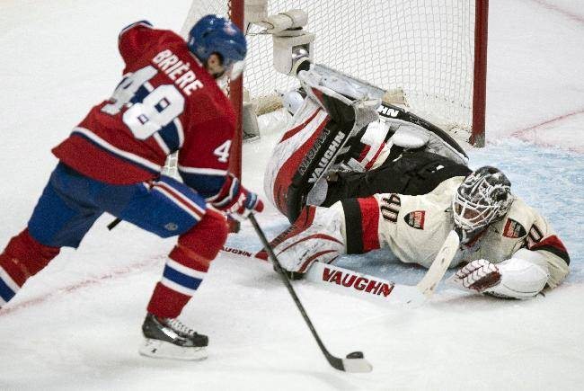 Ottawa Senators goalie Robin Lehner, right, makes a save off Montreal Canadiens' Daniel Briere during the first period of an NHL hockey game Saturday, March 15, 2014, in Montreal