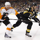 Philadelphia Flyers' Scott Hartnell (19) and Boston Bruins' Zdeno Chara (33) battle for the puck in the first period of an NHL hockey game in Boston, Saturday, April 5, 2014. The Bruins won 5-2 The Associated Press