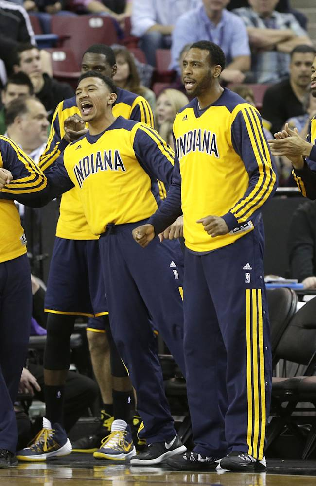 The Indiana Pacers celebrate after scoring against the Sacramento Kings during the fourth quarter of an NBA basketball game in Sacramento, Calif., Friday, Jan. 24, 2014. The Pacers won 116-111 in overtime
