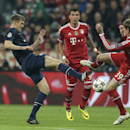 Manchester United's Darren Fletcher, left, is challenged by Bayern's Toni Kroos during the Champions League quarterfinal second leg soccer match between Bayern Munich and Manchester United in the Allianz Arena in Munich, Germany, Wednesday, April 9, 2014