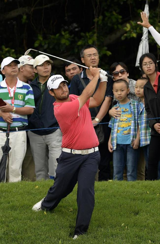 In this photo released by OneAsia, Alexander Levy of France watches his shot during the third round of the Volvo China Open at Genzon Golf Club in Shenzhen, southern China, Saturday, April 26, 2014