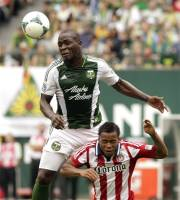 Portland Timbers defender Andrew Jean-Baptiste, left, goes high over Chivas USA forward Tristan Bowen to head the ball during the first half of an MLS soccer game in Portland, Ore., Sunday, May 12, 2013. (AP Photo/Don Ryan)
