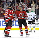 New Jersey Devils' Jacob Josefson, center, celebrates with Eric Gelinas (22) after Gelinas scored during the first period of an NHL hockey game against the Dallas Stars, Friday, Oct. 24, 2014, in Newark, N.J The Associated Press