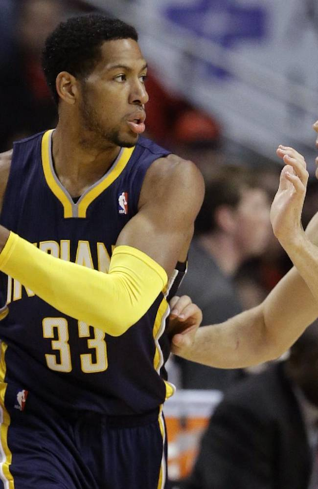 Indiana Pacers forward Danny Granger (33) looks to a pass as Chicago Bulls guard Mike Dunleavy (34) guards during the first half of an NBA preseason basketball game in Chicago on Friday, Oct. 18, 2013