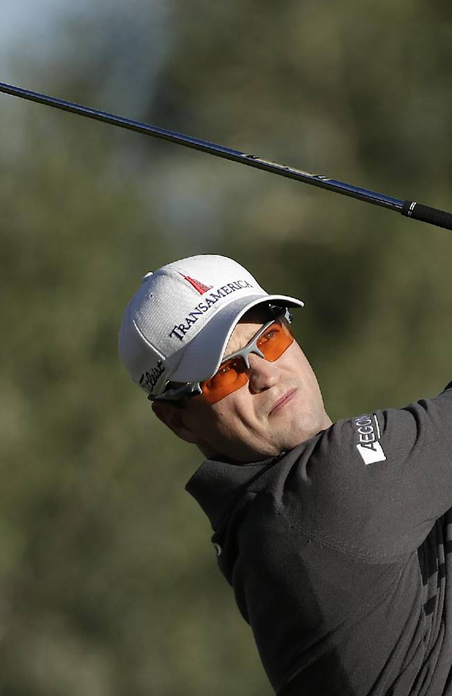 Zach Johnson tees off on the 14th hole during the first round of the Shriners Hospitals for Children Open golf tournament, Thursday, Oct. 17, 2013, in Las Vegas