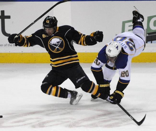 Buffalo Sabres center Tyler Ennis (63) collides with St. Louis Blues left winger Alexander Steen during the third period of an NHL hockey game in Buffalo, N.Y., Tuesday, Nov. 19, 2013.  St Louis won 4-1