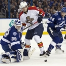 Tampa Bay Lightning goalie Anders Lindback (39), of Sweden, makes a save on a shot by Florida Panthers center Drew Shore (15)