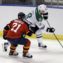 Dallas Stars right wing Patrick Eaves (18) drives as Florida Panthers center Vincent Trocheck (21) defends during the first period of an NHL hockey preseason game in Sunrise, Fla., Wednesday, Sept. 24, 2014. The Associated Press