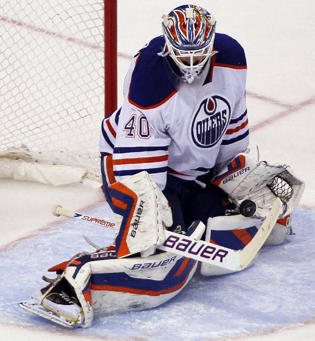 Edmonton Oilers goalie Devan Dubnyk blocks a shot during the third period of an NHL hockey game with the  Philadelphia Flyers, Saturday, Nov. 9, 2013, in Philadelphia. The Flyers won 4-2