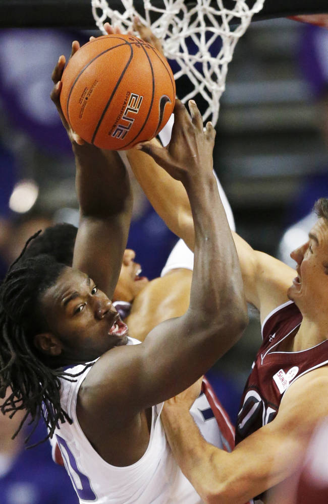 Kansas State forward D.J. Johnson, left, rebounds against Troy guard Jeff Mullahey, right, during the second half of an NCAA college basketball game at Bramlage Coliseum in Manhattan, Kan., Sunday, Dec. 15, 2013. Kansas State defeated Troy 72-43