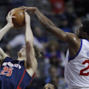 Philadelphia 76ers forward Thaddeus Young blocks a shot by Detroit Pistons guard Kyle Singler (25) but is whistled for his sixth foul in the fourth quarter of an NBA basketball game on Sunday, Dec. 1, 2013, in Auburn Hills, Mich. The Pistons defeated the