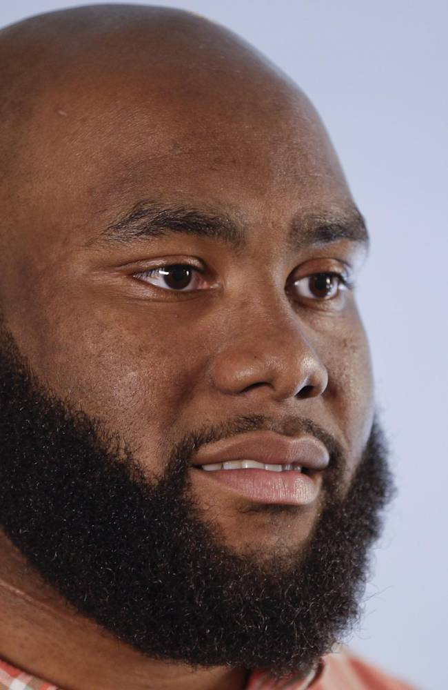 NFL Draft prospect Morgan Moses, an offensive tackle from Virginia, responds to questions during an interview at the 5th Annual NFL Pre-Draft Gifting & Style Suite at the Sean John showroom Tuesday, May 6, 2014, in New York