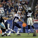 New England Patriots quarterback Tom Brady, second from right, passes over Carolina Panthers free safety Charles Godfrey (30) in the first half of an NFL preseason football game Friday, Aug. 22, 2014, in Foxborough, Mass The Associated Press