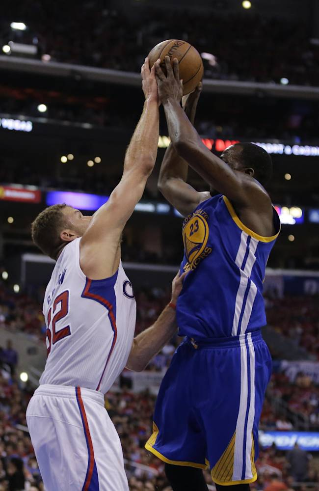 Los Angeles Clippers forward Blake Griffin, left, blocks a shot by Golden State Warriors forward Draymond Green during the second half in Game 2 of an opening-round NBA basketball playoff series in Los Angeles, Monday, April 21, 2014