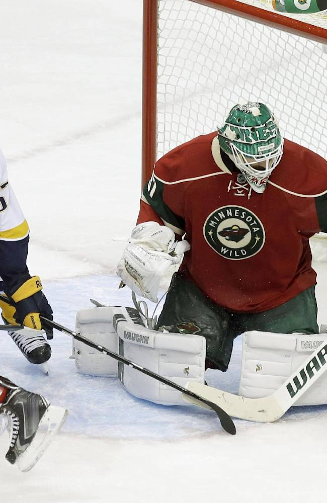 Nashville Predators' Gabriel Bourque, left, tries to reach for the puck as Minnesota Wild goalie Josh Harding  stops a shot in the third period of an NHL hockey game, Tuesday, Oct. 22, 2013, in St. Paul, Minn. The Wild won 2-0