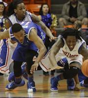 Tulsa and Louisiana Tech players scramble for a loose ball during the second half an NCAA college basketball game in the championship of the Conference USA tournament Saturday March 15, 2014 in El Paso, Texas. The players are Tulsa's James Woodard, left, and Shaqquille Harrison, right, and Louisiana Tech's Cordarius Johnson, center, and Kenneth Smith, left. (AP Photo/Victor Calzada)