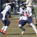 Denver Broncos safety David Bruton Jr., left, squares off against cornerback Aqib Talib as they take part in a drill during a team practice for an NFL football divisional playoff game against the Indianapolis Colts Thursday, Jan. 8, 2015, in Englewood, Co
