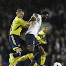 Tottenham's Emmanuel Adebayor, right, vies for the ball with Sunderland's Lee Cattermole during the English Premier League soccer match between Tottenham Hotspur and Sunderland at White Hart Lane stadium in London, Monday, April 7, 2014