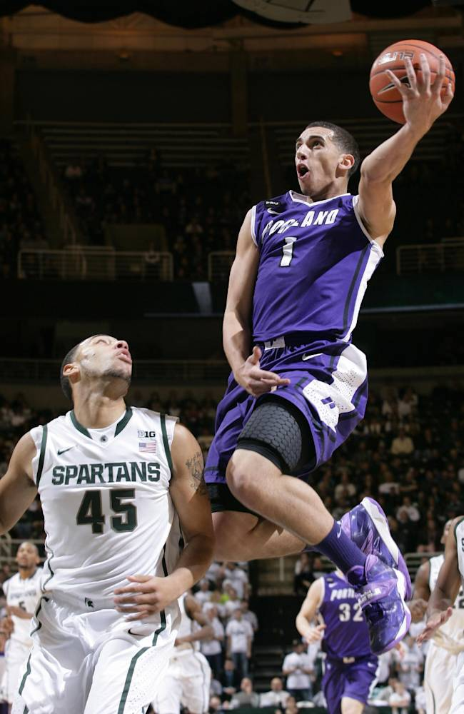 Portland Alec Wintering (2) puts up a layup against Michigan State's Denzel Valentine (45) during the first half of an NCAA college basketball game, Monday, Nov. 18, 2013, in East Lansing, Mich
