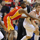 Houston Rockets' Terrence Jones (6) defends an outlet pass from Portland Trail Blazers' Robin Lopez (42) during the first half of an NBA basketball game in Portland, Ore.,Thursday Dec. 12, 2013 The Associated Press