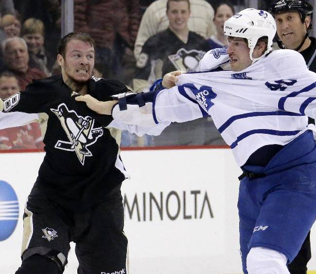 Pittsburgh Penguins' Zach Sill, left, fights with Toronto Maple Leafs' Troy Bodie (40) in the second period of an NHL hockey game in Pittsburgh, Monday, Dec. 16, 2013. The Penguins won 3-1