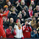 Liverpool's Daniel Sturridge celebrates scoring on his return to the first team during their English Premier League soccer match against West Ham at Anfield, Liverpool, England, Saturday, Jan. 31, 2015