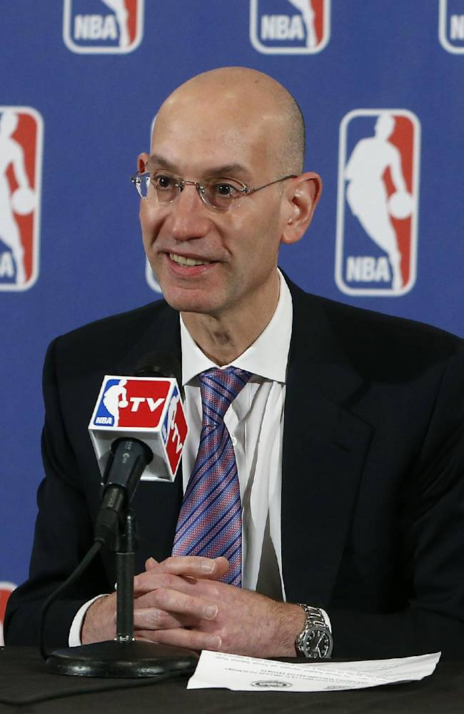 In this May 21, 2013 file photo, Adam Silver speaks during a news conference before the NBA basketball draft lottery in New York. Silver became the NBA's fifth commissioner on Feb. 1, 2014, responsible for continuing the growth the league saw under David Stern