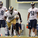 Rams defensive end Michael Sam (96) practices during the first day of NFL football training camp for rookies on Tuesday, July 22, 2014, at Rams Park in Earth City, Mo The Associated Press
