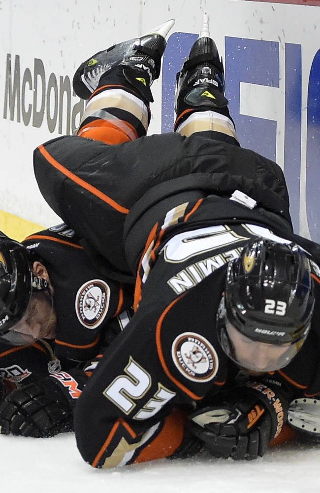 Anaheim Ducks defenseman Francois Beauchemin, right, falls over center Saku Koivu, of Finland, during the first period in Game 2 of an NHL hockey second-round Stanley Cup playoff series against the Los Angeles Kings, Monday, May 5, 2014, in Anaheim, Calif