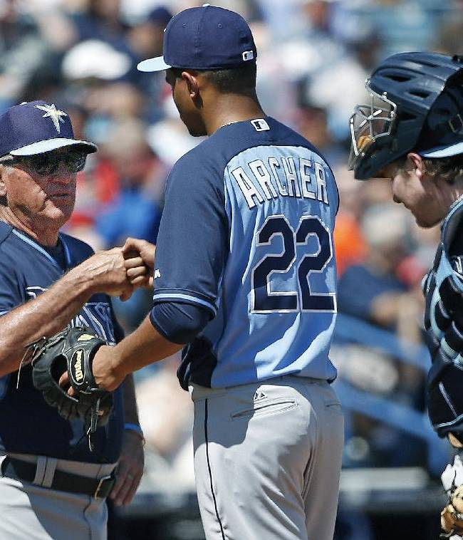 Tampa Bay Rays manager Joe Maddon, left, congratulates Rays starting pitcher Chris Archer (22) during a fourth-inning pitching change during a spring training baseball game against the New York Yankees in Tampa, Fla., Sunday, March 9, 2014. Rays catcher Ryan Hanigan joins the pair on the mound for the change