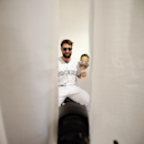Colorado Rockies right fielder Charlie Blackmon poses in a photo booth with a cutout image of teammate left fielder Carlos Gonzalez during the team photo day before a spring training baseball workout Wednesday, Feb. 26, 2014, in Scottsdale, Ariz The Assoc