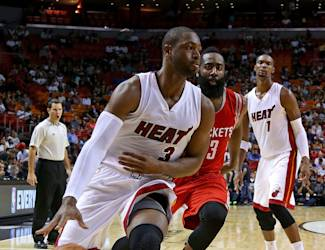 MIAMI, FL - OCTOBER 21: Dwyane Wade #3 of the Miami Heat drives on James Harden #13 of the Houston Rockets during a preseason game at American Airlines Arena on October 21, 2014 in Miami, Florida. (Photo by Mike Ehrmann/Getty Images)