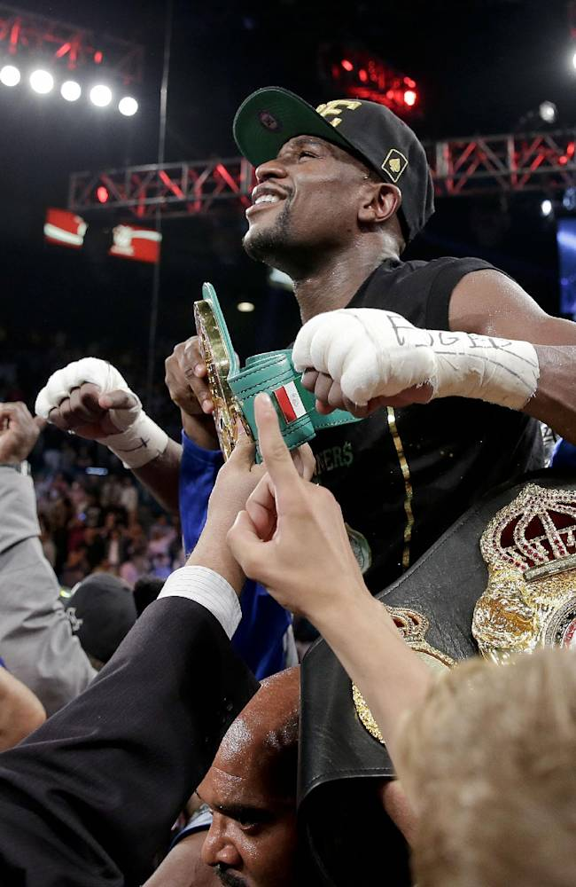 Floyd Mayweather Jr. celebrates after defeating Canelo Alvarez in a 152-pound title fight, Saturday, Sept. 14, 2013, in Las Vegas