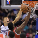 Los Angeles Clippers forward Blake Griffin, left, blocks the shot of Milwaukee Bucks forward Jeff Adrien during the first half of an NBA basketball game, Monday, March 24, 2014, in Los Angeles The Associated Press
