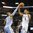 Memphis Grizzlies forward Courtney Lee (5) drives against Denver Nuggets guard Randy Foye (4) in the second half of an NBA basketball game Friday, April 4, 2014, in Memphis, Tenn. The Grizzlies won 100-92 The Associated Press