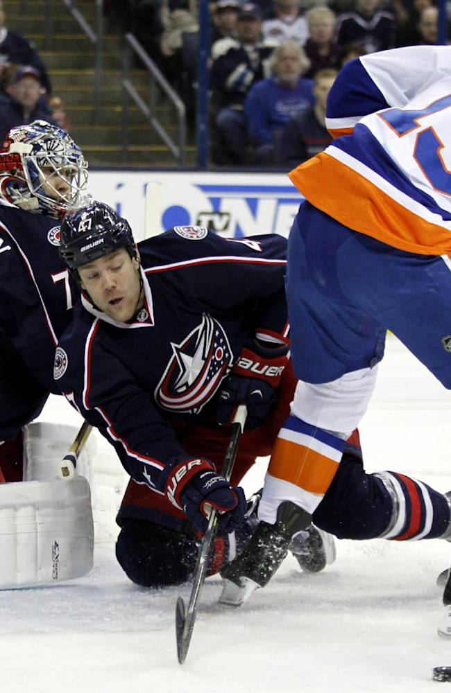 Columbus Blue Jackets' Dalton Prout (47) clears the puck away from New York Islanders' Colin McDonald (13) as Blue Jackets goalie Sergi Bobrovsky (72), of Russia, looks on in the first period of an NHL hockey game in Columbus, Ohio, Sunday, April 6, 2014