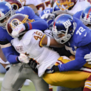 Washington Redskins running back Alfred Morris (46) is tackled by New York Giants defensive end Damontre Moore (98) and defensive end Kerry Wynn (72) during the third quarter of an NFL football game, Sunday, Dec. 14, 2014, in East Rutherford, N.J The Asso