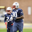 New England Patriots defensive end Zach Moore (90) and cornerback Darrelle Revis (24) warm up during practice Friday, Jan. 30, 2015, in Tempe, Ariz. The Patriots play the Seattle Seahawks in NFL football Super Bowl XLIX Sunday, Feb. 1 The Associated Press